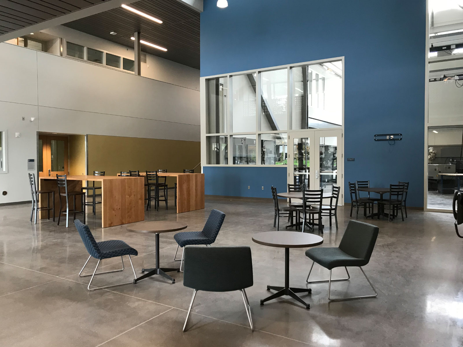 The Industrial Technology Center's lobby, with a vast space, seating and table areas, at the Oregon City campus