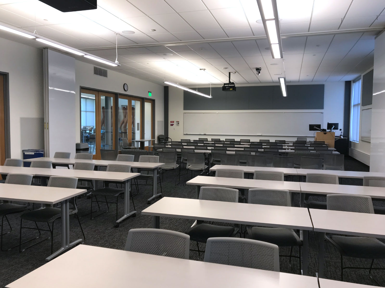 A classroom with many rows of tables and chairs in the Industrial Technology Center