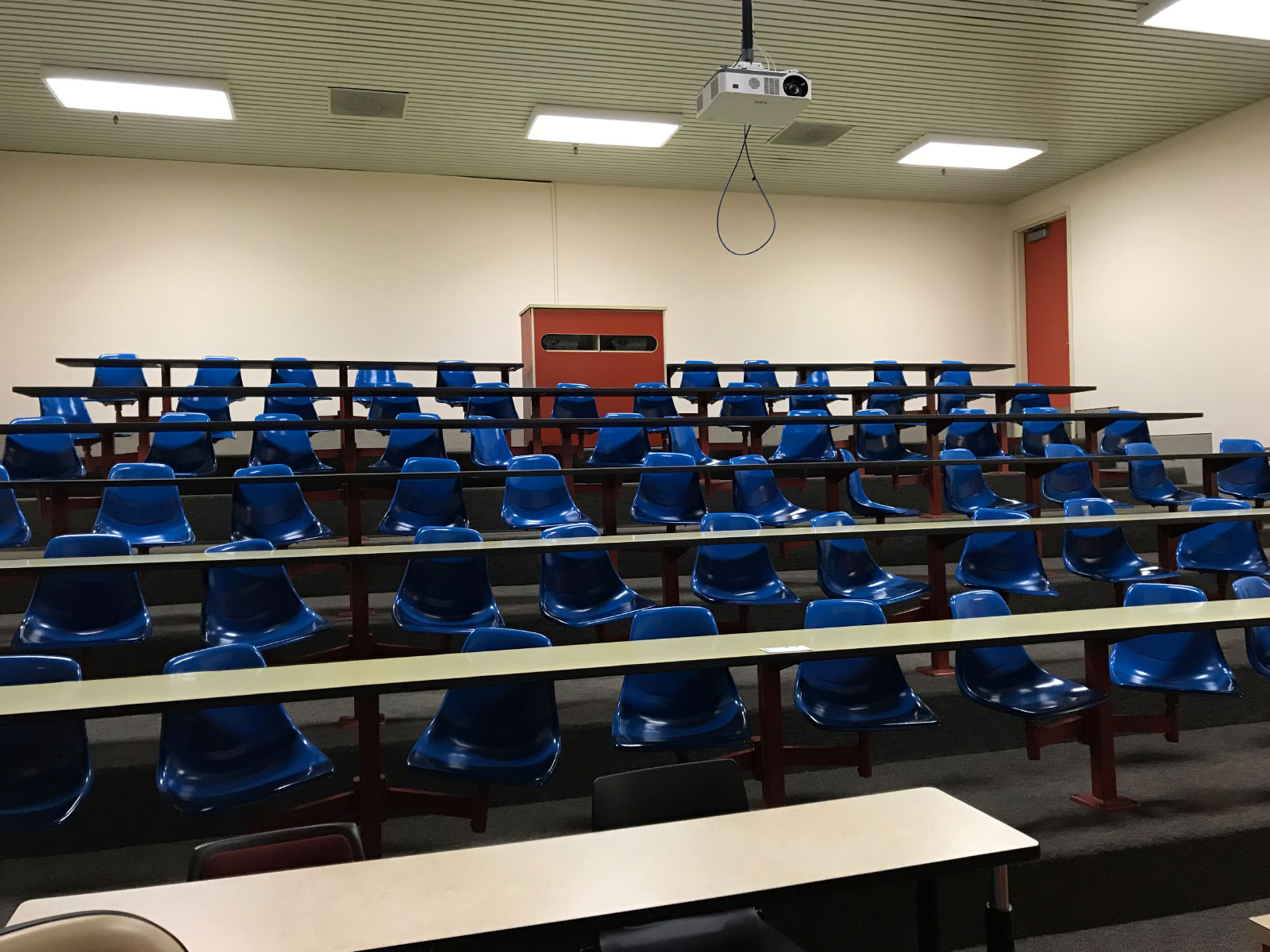 The Pauling Lecture Hall with dozens of blue, swiveling seats, located at the Oregon City campus