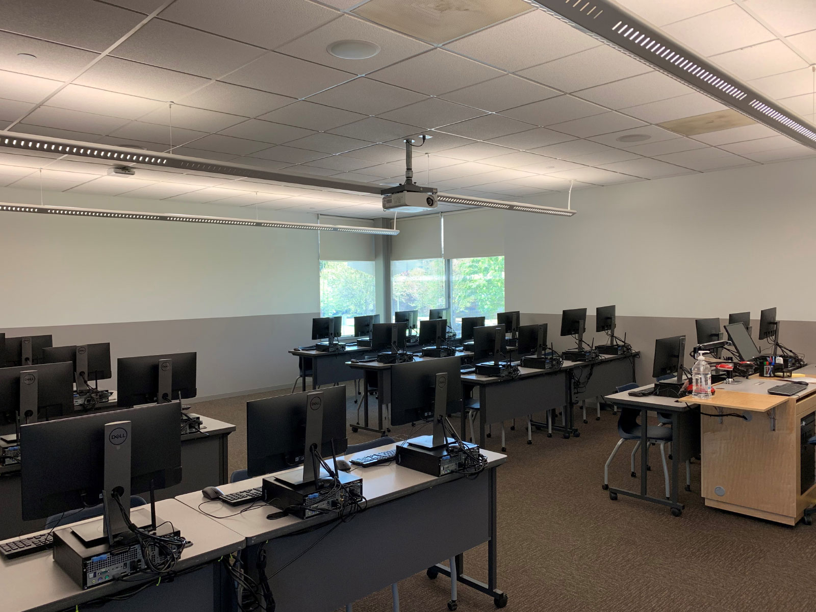Angled reverse view of rows of computers on desks in Wilsonville's computer lab