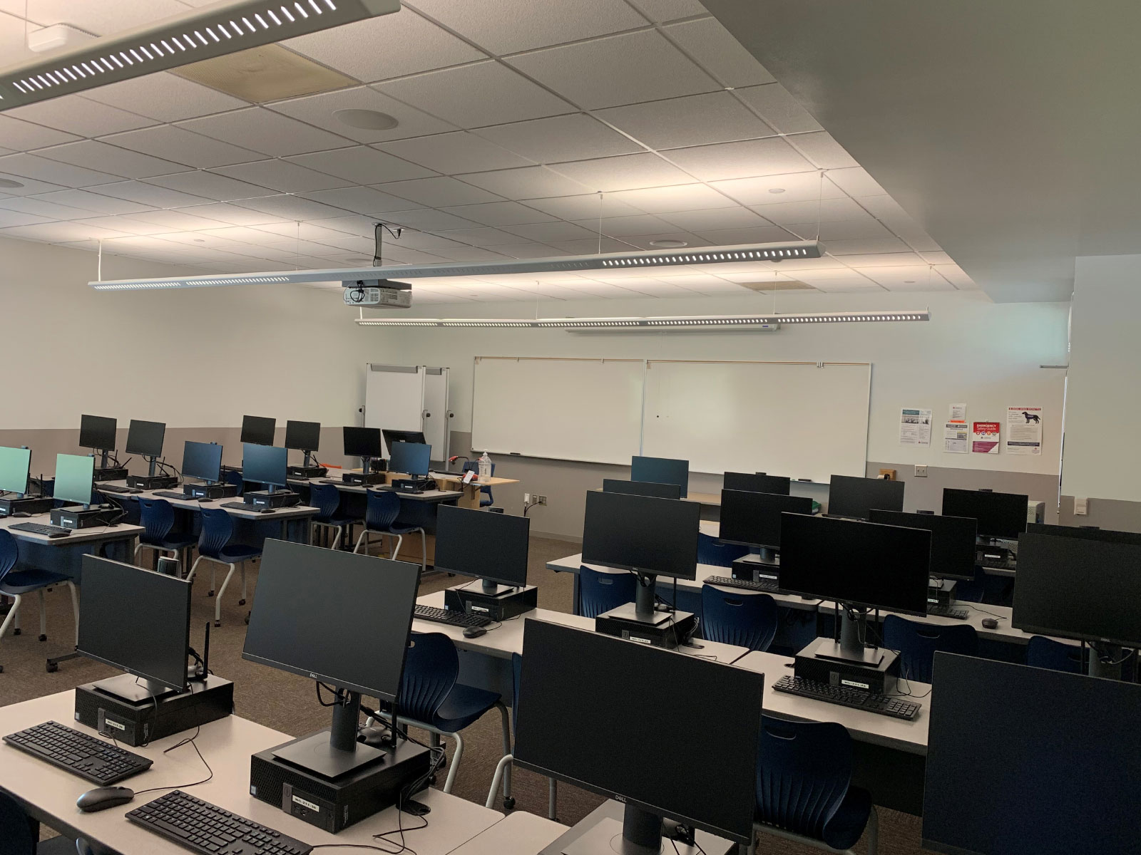 Angled front view of rows of computers on desks in Wilsonville's Computer Lab W211